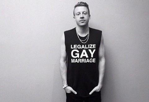 "Macklemore wearing a t-shirt that says ""Legalize Gay Marriage"""